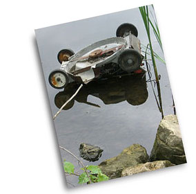 mower in pond